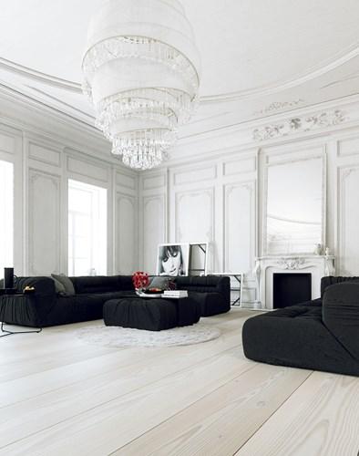 Ghế sofa màu đen kết hợp với tường trang trí cầu kỳ, phủ sơn trắng là cách hoàn hảo để mang đến một phòng khách phong cách cổ điển đúng nghĩa