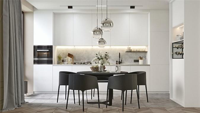 Tủ bếp màu trắng mang đến cảm giác gần như trong suốt, đèn âm tường giấu đằng sau tủ hỗ trợ chị em trong lúc nấu nướng đồng thời tạo điểm nhấn cho căn bếp