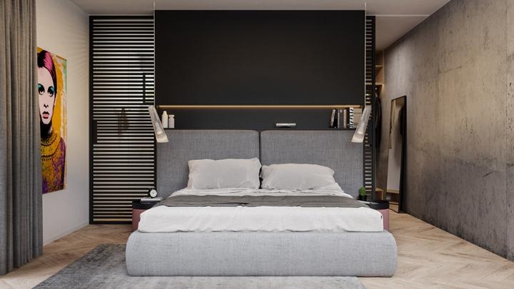 Trong phòng ngủ chính, giường ngủ và thảm trải sàn có cùng màu xám giống với màu sắc tường