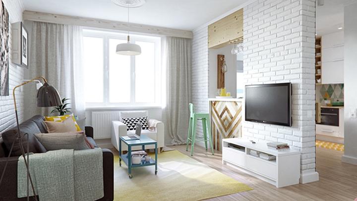 Bếp ngăn cách với phòng khách bằng bức tường ở giữa tạo khoảng thở cần thiết