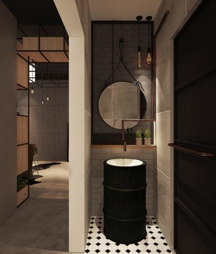 Đằng sau phòng khách có một phòng tắm nhỏ, bồn rửa tay làm từ thùng dầu rỗng cùng ống dẫn nước bằng đồng