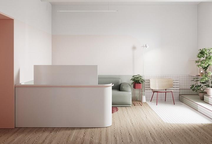 Một bức tường thấp ngăn phòng khách với những khu vực chức năng khác trong nhà