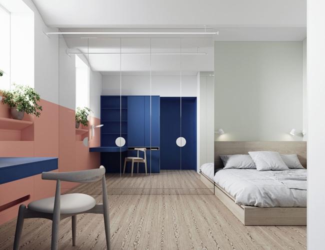 Phòng ngủ cũng được sử dụng những gam màu sôi nổi, một tấm gương lớn giúp tăng chiều rộng cho căn phòng
