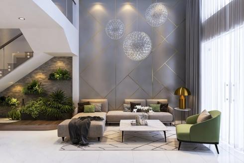 Bức tường màu ghi có viền kẻ và chùm đèn tròn như những chùm pháo hoa rực sáng là điểm nhấn cho phòng khách