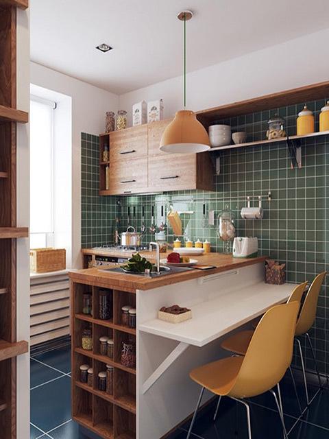 Với những không gian nhà bếp nhỏ hẹp thì nội thất đa chức năng chính là lựa chọn hoàn hảo. Chiếc bàn nhỏ xinh này có tới 4 chức năng, vừa là tủ để đồ, vừa làm bàn bar giúp không gian bếp sống động, vừa làm bàn để sơ chế thức ăn, khi cần lại có thể biến thành bàn ăn tiện lợi.