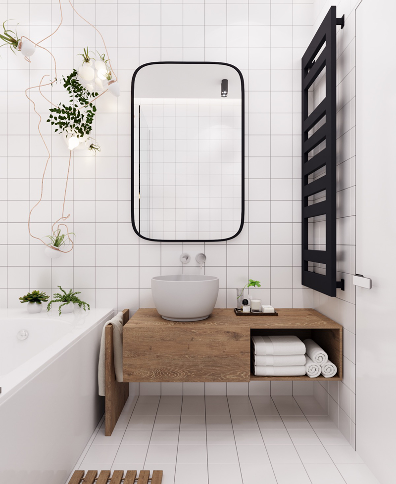 Kệ đựng đồ bằng gỗ là mảng tương phản tuyệt đẹp với tường phòng tắm màu trắng
