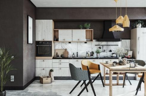 Tủ bếp màu trắng trở nên nổi bật hơn khi được bố trí trên nền tường màu nâu
