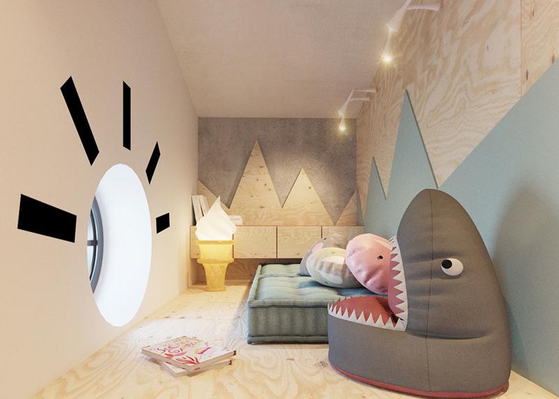 Căn phòng được thiết kế bắt mắt khi ô tròn ở tường được thiết kế như hình mặt trời, còn trên tường dán hình như những dãy núi. Với căn phòng chật hẹp như này, bạn có thể kê luôn đệm xuống dưới sàn