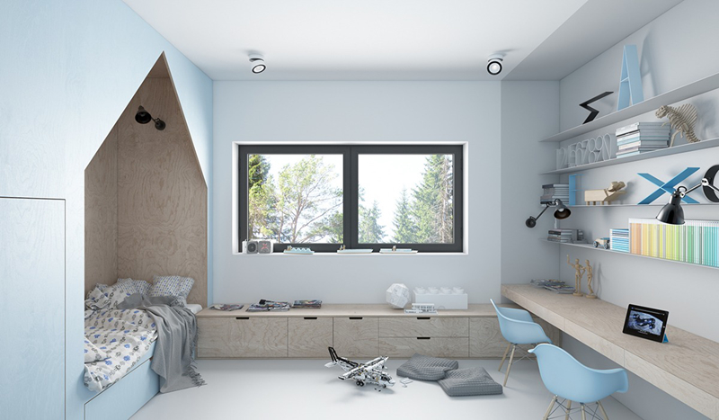 Căn phòng được tận dụng diện tích khi dưới giá để sách là kê một tấm gỗ dài để trẻ có thể ngồi học bài