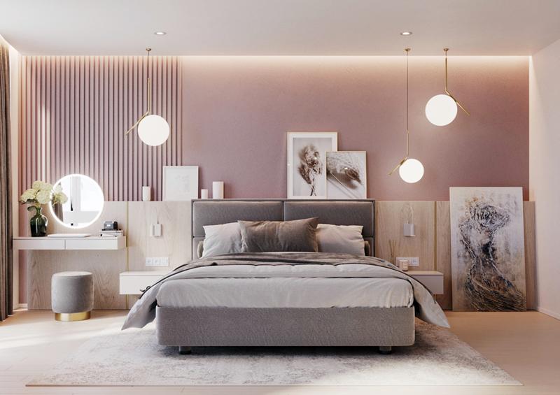 Những chiếc đèn tròn từ trên trần nhà rủ xuống đã góp phần tỏa sáng hơn cho phòng ngủ màu hồng phấn