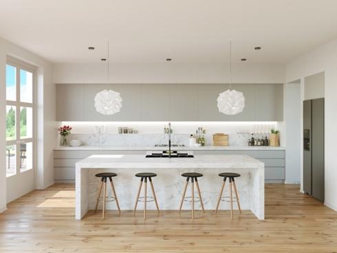 Không gian phòng bếp trở nên sáng sủa hơn bởi 2 chiếc đèn màu trắng như 2 bông hoa được kéo thẳng từ trần nhà xuống bàn ăn