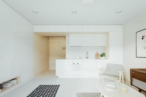 Chiếc thảm màu đen có vân kẻ trắng đã làm nổi bật cho căn phòng có tủ bếp, tường, trần và sàn nhà đều là màu trắng