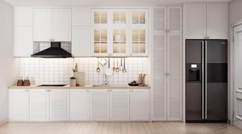 Sự khác lạ của tủ bếp màu trắng này là có thêm cánh cửa tủ được chia thành những viền nhỏ và có thêm ô cửa kính ở tầng trên