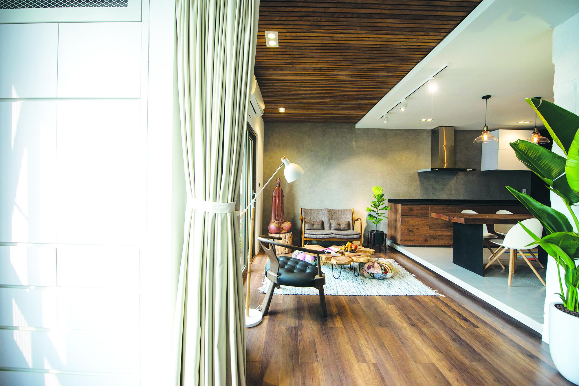 Không gian phòng khách và bếp ăn được thiết kế tối giản
