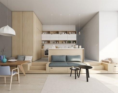 Việc đẩy cao phần sàn gỗ nhà bếp giúp nó tách biệt với phòng khách mà không cần đến một bức tường ngăn nào