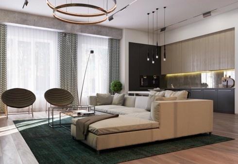 Một tấm thảm lớn cùng ghế sofa đánh dấu khu vực tiếp khách
