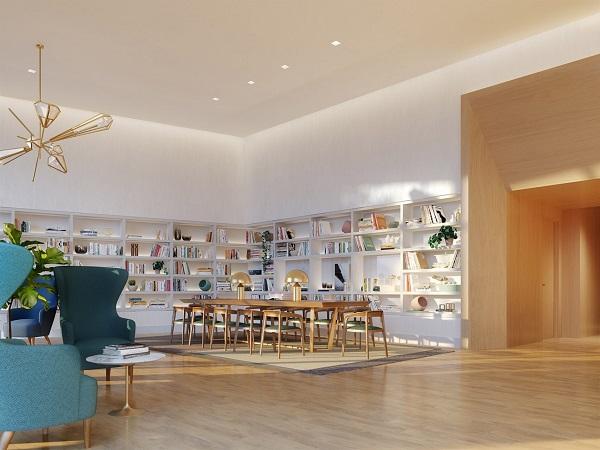 Bên trong, các căn hộ có kiến trúc thiết kế đơn giản, gồm sàn gỗ màu nhạt và tường trắng, có kệ sách lớn màu trắng và một cái bàn dài.