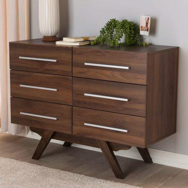 Tông màu gỗ của tủ sẽ tăng thêm sự ấm áp cho phòng ngủ