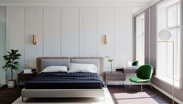 Tạo điểm nhấn trong phòng ngủ màu trắng bằng hai chiếc đèn màu vàng đồng, ghế thư giãn màu xanh mang lại những phút giây thư giãn, yên tĩnh
