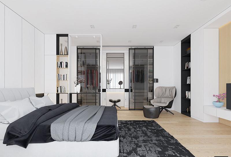 Bức tường nhỏ giữa giường và tủ quần áo tạo ra một hành lang giả nhỏ, một ranh giới mang tính biểu tượng thuần túy vẫn cho phép ánh sáng mặt trời tiếp tục hướng về các khu vực chức năng ở phía bên kia