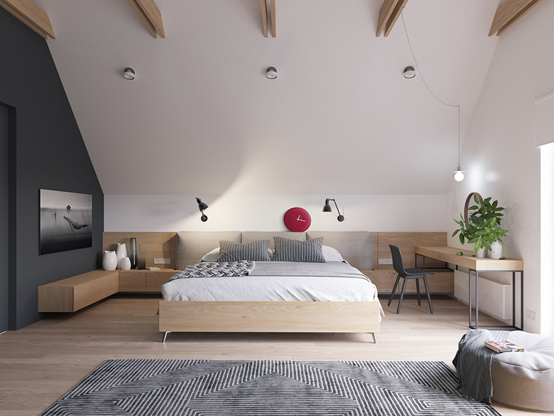 Phòng ngủ chính rộng rãi, chiếc đồng hồ màu đỏ, tranh treo tường, chậu cây độc đáo… thể hiện gu thẩm mỹ đáng nể của chủ nhân