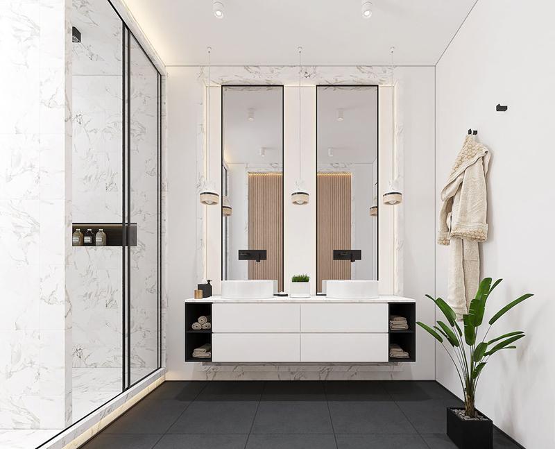 Phòng tắm chính không ngại sử dụng các vật liệu cao cấp. Ốp đá cẩm thạch làm cho bồn rửa nổi bật