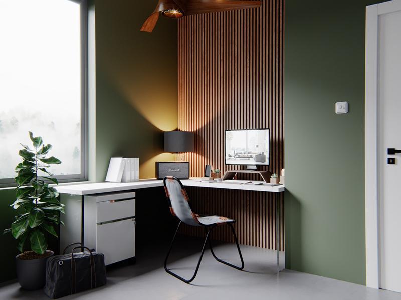 Bức tường gỗ tăng sự tập trung cho những mảng tường màu xanh lá xung quanh.