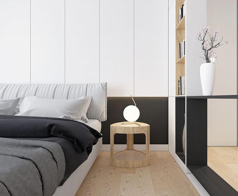 Một chiếc đèn ngủ nhỏ đặt trên bàn cạnh giường dùng để đọc sách