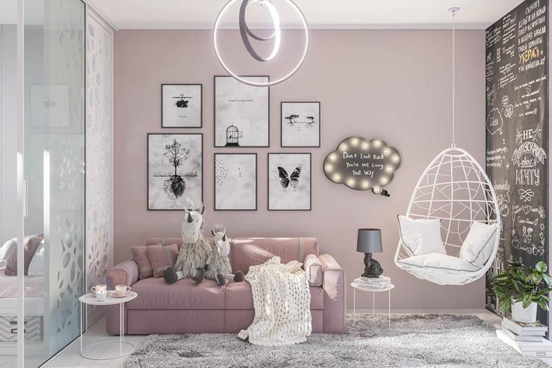Màu hồng và trắng là những màu chủ đạo cho căn phòng. Đặc biệt, chiếc ghế đu màu trắng có thể giúp trẻ ngồi đua đưa trong chính căn phòng ấm áp của mình.