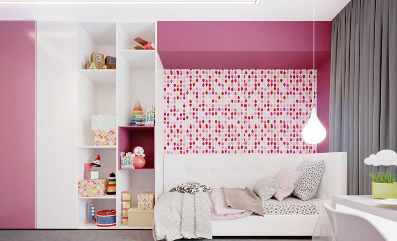 Phòng của trẻ có giường ngủ và tủ kê sát nhau.Chiếc tủ màu hồng pha trắng được thiết kế có những ô hở không cánh, thuận tiện để trẻ bày biện đồ chơi.