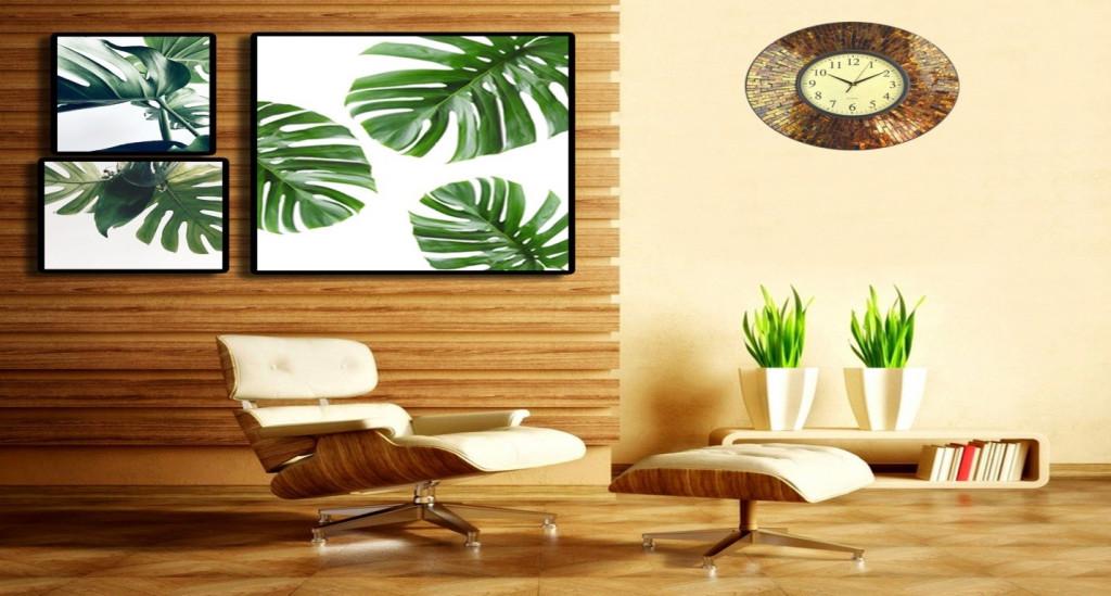 Tranh treo tường và cây xanh được bố trí hợp lý sẽ mang lại không gian tươi mát, mới mẻ cho gia đình bạn