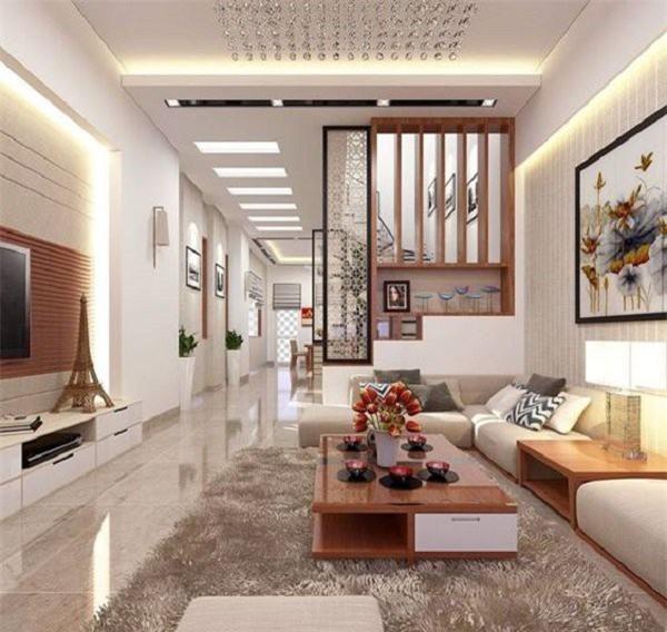 Bên cạnh vách ngăn phòng khách và bếp bằng tường, vách gỗ có tính chống chịu tốt, bền vững theo thời gian. (Ảnh minh họa)
