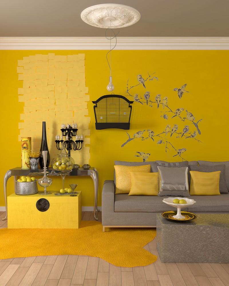 Bức tường, thảm trải sàn và một số đồ vật màu vàng chanh đã khiến cho phòng khách trở nên ấm áp và sang trọng hơn.