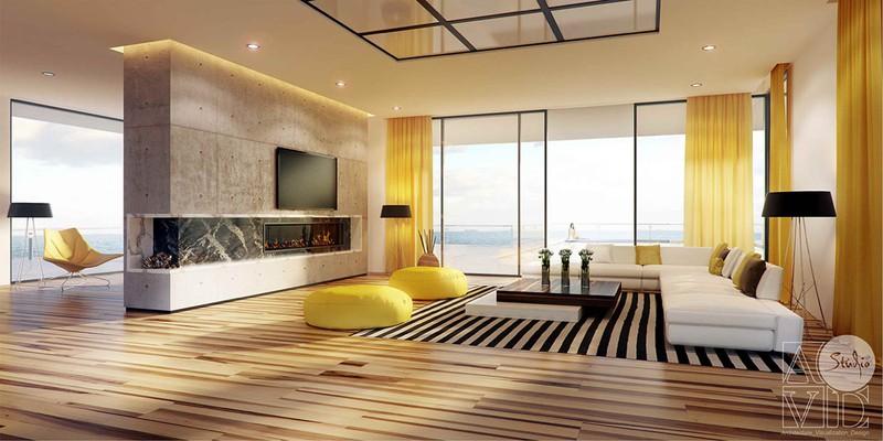 Phòng khách có hướng nhìn ra biển, mang phong cách hiện đại. Sàn gỗ vân màu vàng kết hợp với rèm cửa màu vàng chanh và bộ bàn ghế sofa dáng thấp là những điểm ấn tượng cho căn phòng.