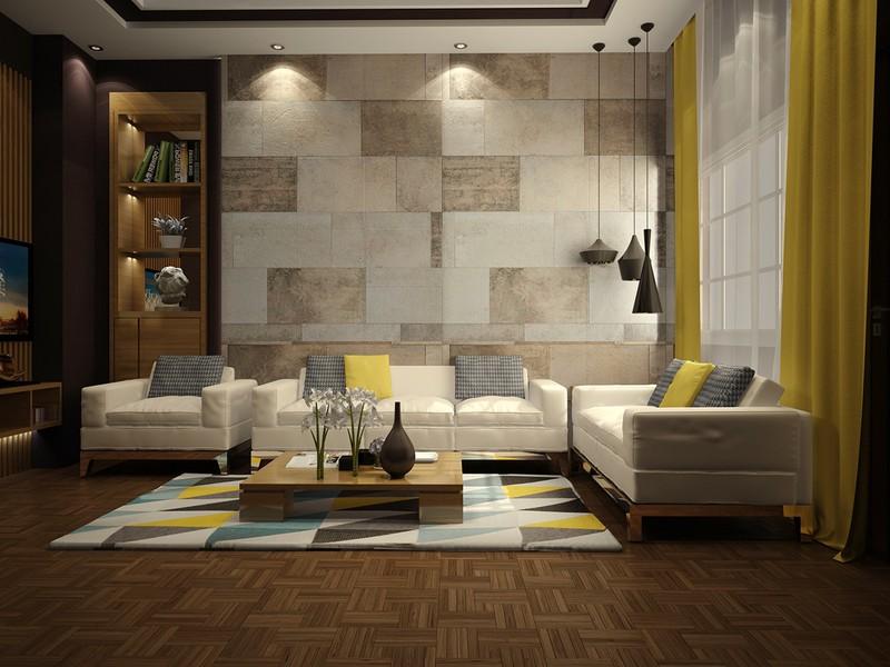 Phòng khách có sự đan xen giữa các màu: vàng chanh, trắng, đen. Bức tường làm bằng những ô gạch đá tạo nên nét độc đáo cho căn phòng.