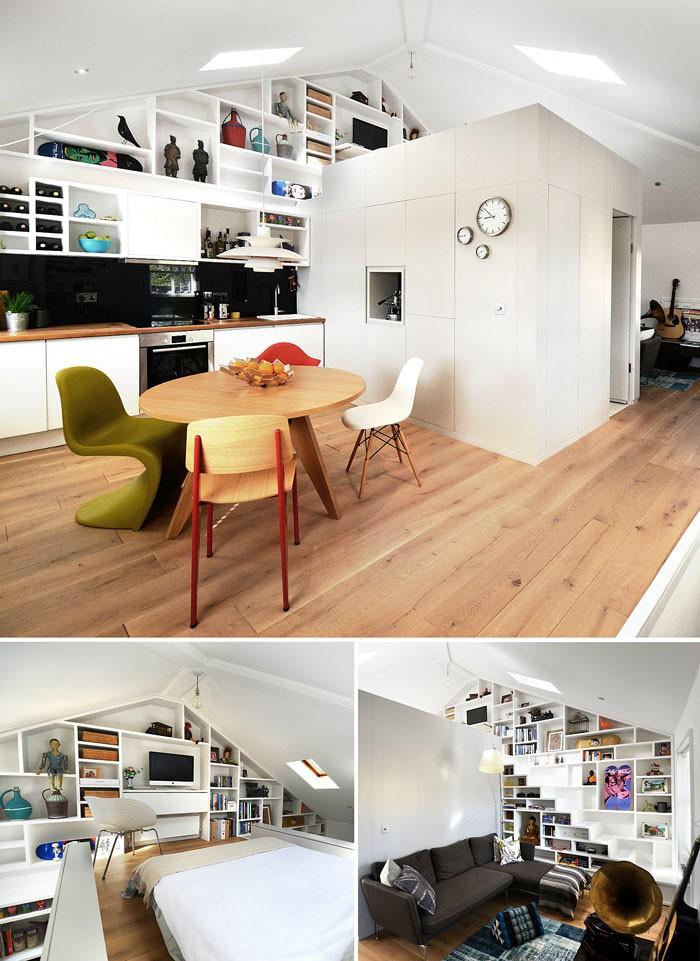 Bức tường này giúp đảm bảo môi trường riêng biệt và sáng tạo, linh hoạt theo yêu cầu của cuộc sống hiện đại. Phòng ngủ trên gác lửng ngăn cách trực quan nhà bếp, khu vực ăn uống liên kết với phòng khách ấm cúng. Ở đây cầu thang dẫn đến tầng lửng được tích hợp, bức tường trang trí chữ A làm điểm nhấn thống nhất trong không gian này.