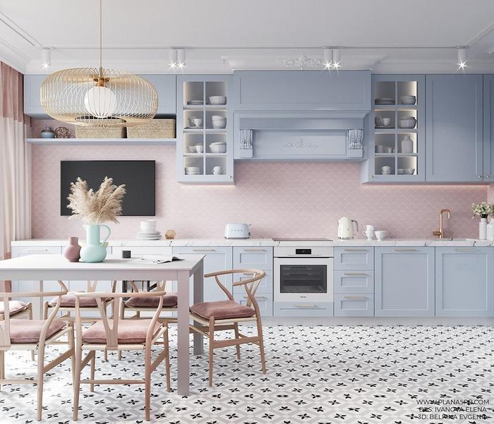 Không gian bếp được bố trí theo hình chữ I với gam màu xanh và hồng pastel đầy cuốn hút.