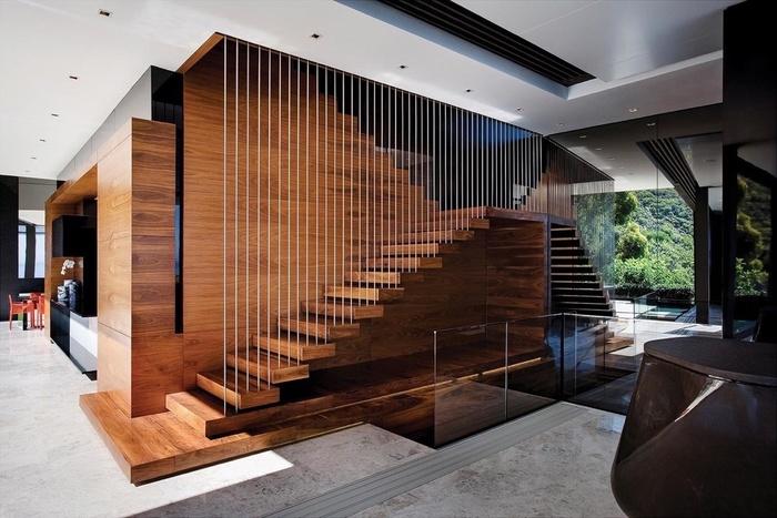Các nhà thiết kế đã kết hợp gỗ với dây thép để làm nên mẫu cầu thang vạn người mê