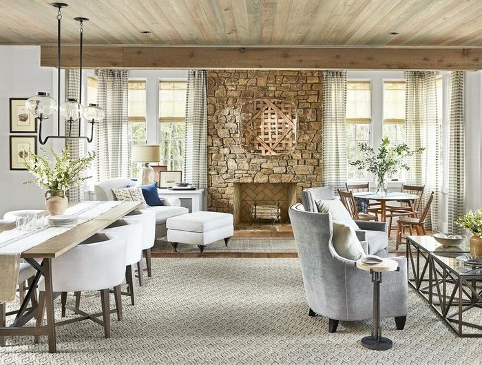 Để tạo ra một phòng khách mộc mạc đầy tinh tế, bạn hãy sắp xếp mọi thứ thật gọn gẽ. Trong không gian sống rộng rãi, có cả khu vực tiếp khách và ăn uống, bạn hãy chọn đồ dùng làm bằng vải và các vật liệu tự nhiên ấm áp.