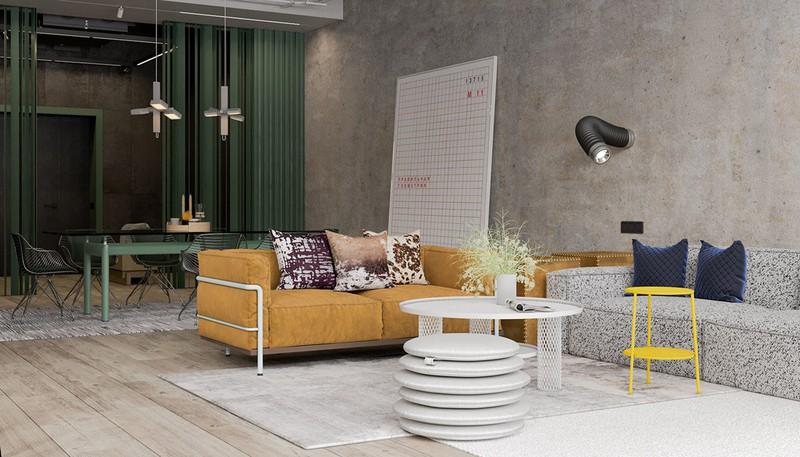 Ghế sofa màu cam nổi bật trên nền tường bê tông đơn giản. Hai chiếc bàn trà màu trắng và vàng cũng góp phần tạo nên diện mạo khác lạ cho căn phòng khách.
