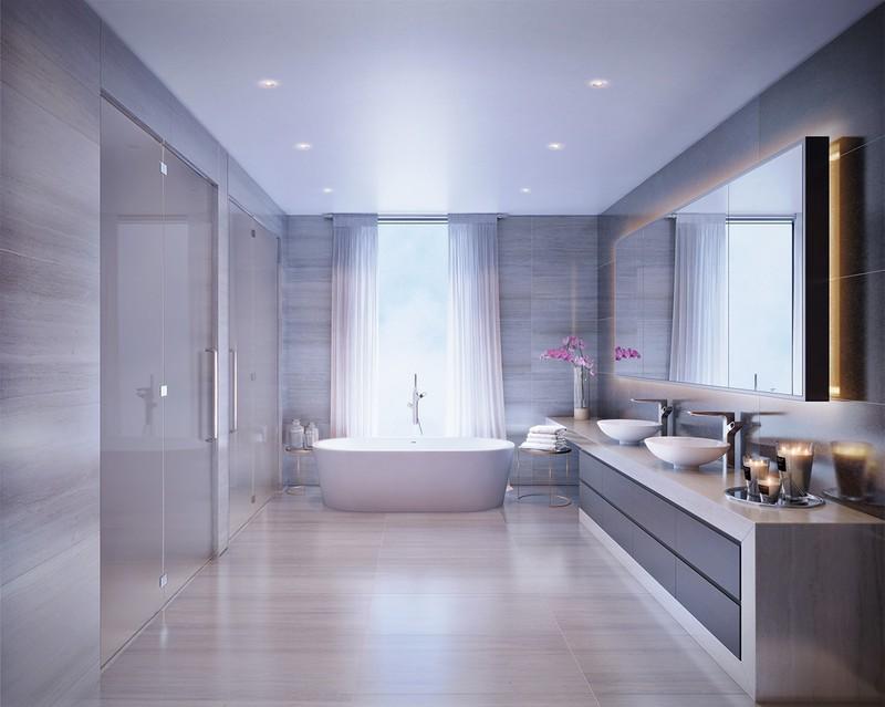 Thiết kế thông minh với rèm cửa, tường kính và một bồn tắm bằng đá cẩm thạch mang đến một nơi thư giãn vừa lãng mạn, vừa ấm cúng mà rất sang trọng.