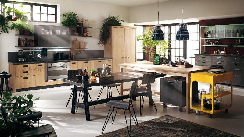 Căn bếp sử dụng bàn ăn thông minh kéo ra từ đảo bếp giúp tiết kiệm tối đa diện tích.