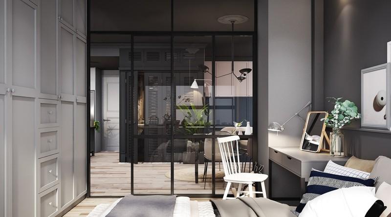 Một bàn trang điểm đặt giữa giường và tường kính. Cửa trượt không chiếm diện tích giúp cho phòng ngủ luôn yên tĩnh.