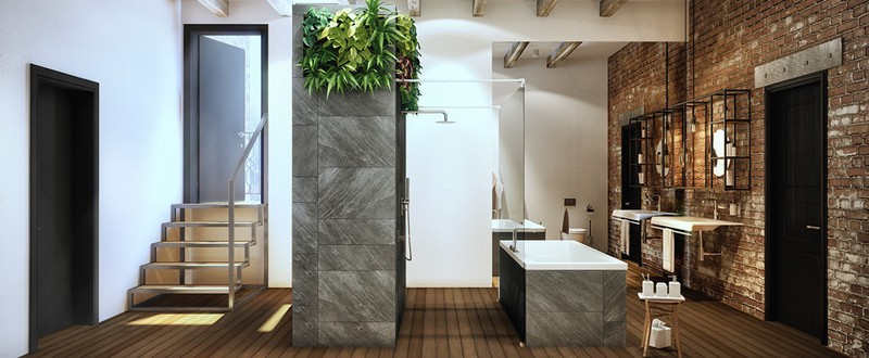 Bồn tắm ốp đá đi kèm tường gạch thô, một sự kết hợp đầy ngẫu hứng mang đến không gian phòng tắm hiện đại và có chút công nghiệp.