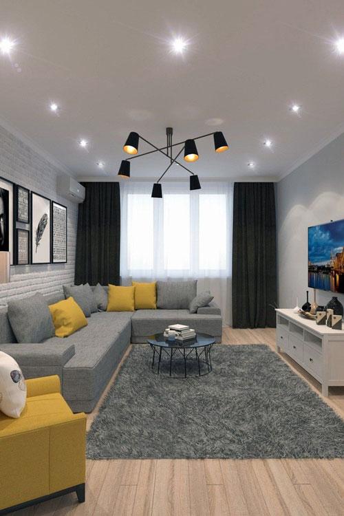 Phòng khách hiện đại đầy phong cách dưới đèn trần và đèn chùm màu đen tạo cảm giác hiện đại