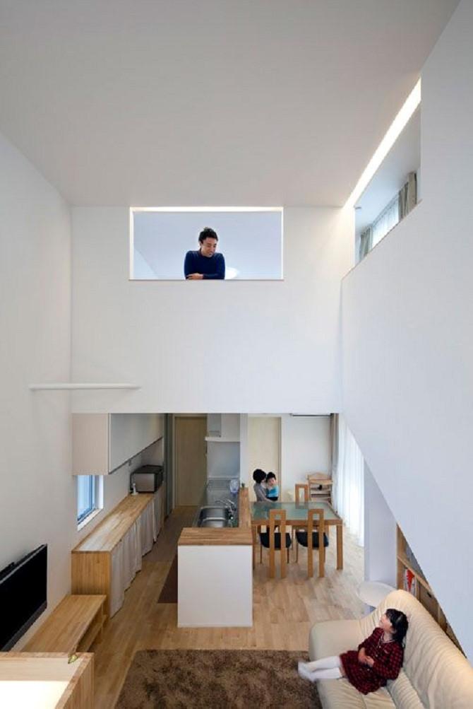 Thêm một thiết kế thông tầng giúp phòng khách rộng và nhiều ánh sáng hơn. Ảnh: Pinterest