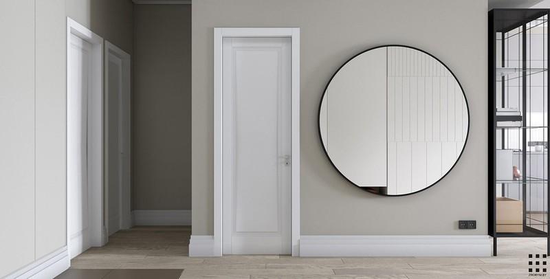Tại hành lang, chủ nhà gắn một chiếc gương tròn để tăng kích thước cho những căn phòng bên trong.