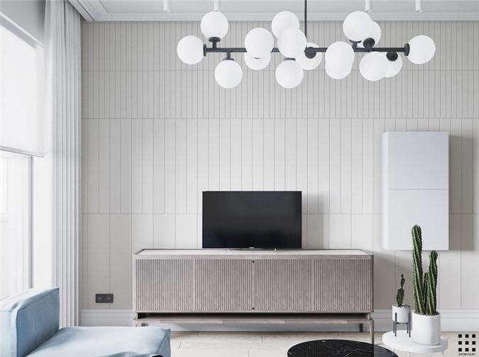 Bức tường tivi được làm bằng những thanh gỗ dọc, chạy theo chiều dài của căn phòng và dọc theo hành lang liền kề.