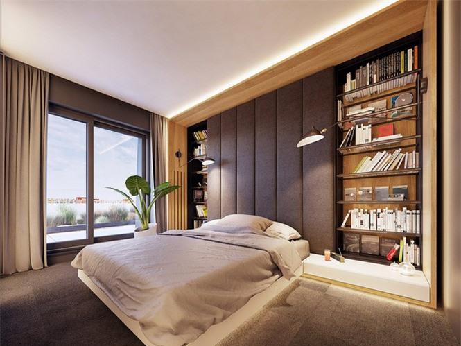 Tường phòng ngủ màu xám cùng cây xanh và gỗ vàng lấy lại màu sắc cho khu vực ngủ nghỉ.