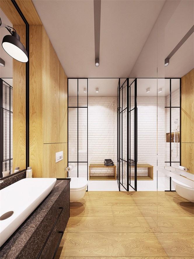 Phòng tắm đóng khung trong gam màu trắng và vàng.